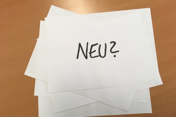 """Neu?"" - black writing on white background"
