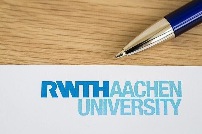 Pen and paper with the RWTH logo
